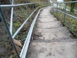 Wheel guide rail up the steps from the canal to the station fitted by Belmont Construction, Bromley Rd, Congleton.